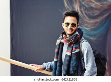 Stylish fashionable indian man in sun glasses