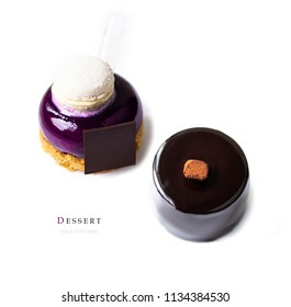 Stylish fashionable new French dessert on isolated white background. View from above. Concept copy for text. Purple cake. Chocolate dessert covered with chocolate icing.