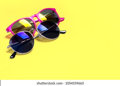 Too stylish fashionable sunglasses isolated on a yellow background. The concept of stylish poster, banner