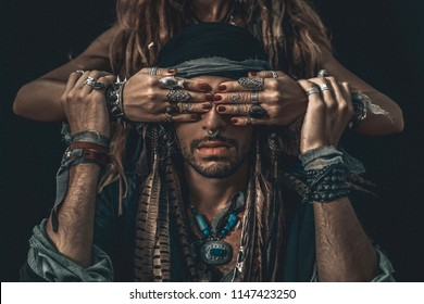 stylish fashionable young handsome man and woman covering his eyes with hands. fashion concept