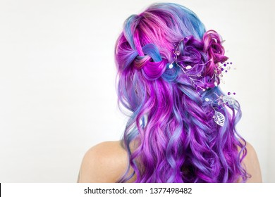 Stylish fashionable young woman with bright hair coloring, Magenta and purple. Beautiful curls, stylish hairstyle for an unusual modern bride