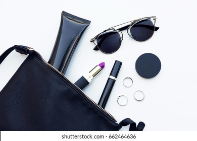 Stylish female accessories sunglasses . Overhead beauty products for woman