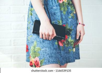 stylish female hand holding wallet