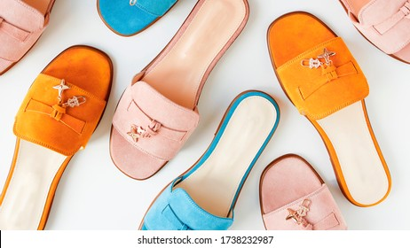 Stylish female spring or summer shoes in various colors. Beauty and fashion concept.Girl's spring summer shoes ollection.Mock up of different styles and colos shoes.Flat lay, top view