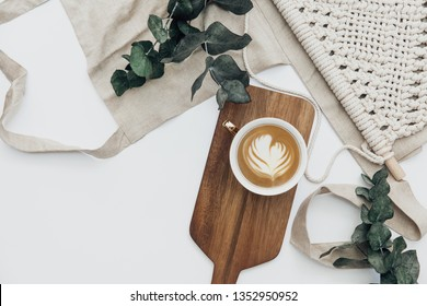 Stylish feminine composition,  table desk. coffee and accessories on white background. Flat composition for magazines, websites, media, Instagram. Flat lay, top view - Image