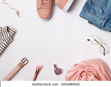 Stylish feminine outfit concept. Clothes and accessories on the white background