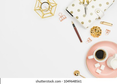 Stylish flatlay arrangement with coffee, milk holder, planner, glasses and other stationary accessories. Feminine business mockup, copyspace, white background