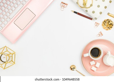 Stylish flatlay frame arrangement with pink laptop, coffee, milk holder, planner, glasses and other accessories. Feminine business mockup, copyspace, white background