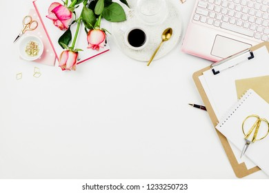 Stylish flatlay frame arrangement with pink laptop, roses, glasses and other accessories on white. Feminine business mockup, copyspace
