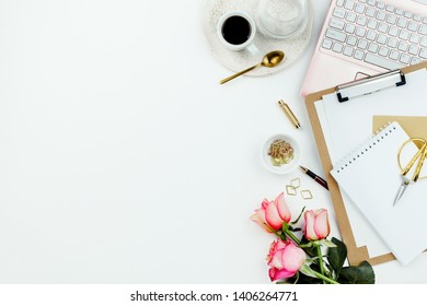 Stylish flatlay frame arrangement with pink laptop, glasses and other accessories on white. Feminine business mockup, copyspace