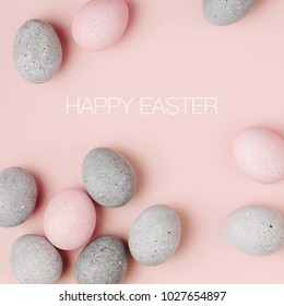 Stylish Frame of pale pink and gray Easter eggs with copy space for text.  Flat lay