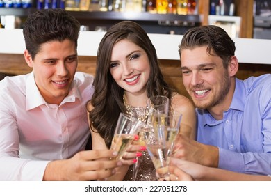 Stylish friends having a drink together at the bar