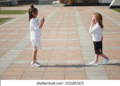 stylish funny little girls on the street
