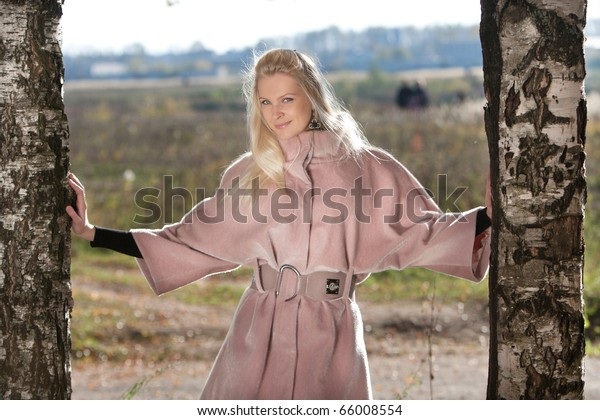 Stylish girl holding two birches