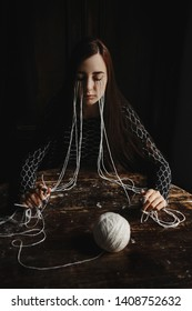 Stylish girl photo with a tangle of threads