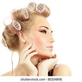 Stylish girl portrait with fashion makeup and hair curlers, isolated on white background, hair and beauty treatment concept