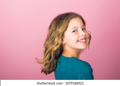 Stylish girl with pretty face on grey background. Hairdresser, skincare, casual style, denim. Fashion model and beauty look. Little girl with long hair. Beauty and kid fashion with healthy hair.