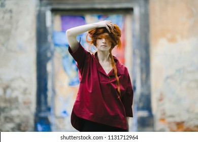 The stylish girl stands near building