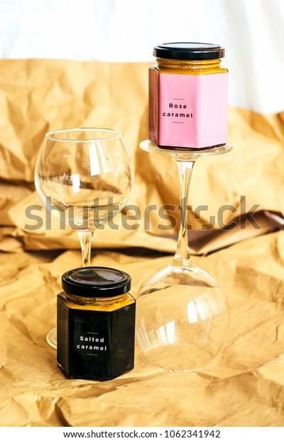 stylish glass jar of caramel. Salad caramel and caramel roses