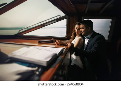 stylish gorgeous cute happy couple ride on a yacht, Mediterranean, sea, mountains, summer