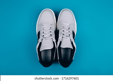 Stylish gray sneakers on a blue background, healthy lifestyle, jogging, sports shoe store
