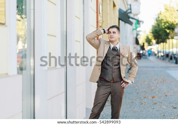 stylish groom in a brown suit. Klaipeda, Lithuania
