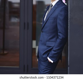 Stylish groom in a suit. Wedding fashion for men