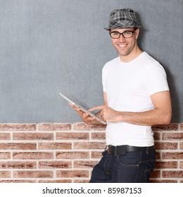 Stylish guy using electronic tablet
