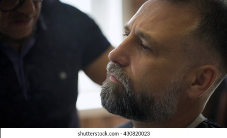 Stylish hair salon, barber engaged beard respectable businessman