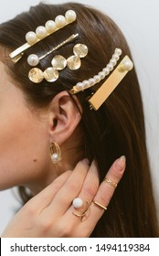 Stylish hairpins for a dark-haired girl. Pearl Earrings.