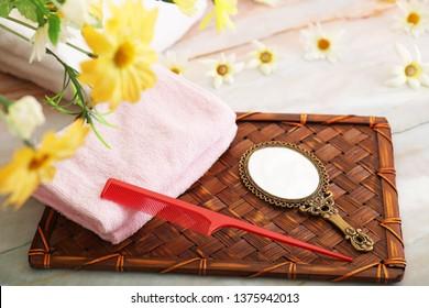 Stylish hand mirror and comb.