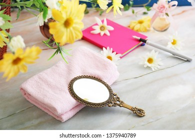 Stylish hand mirror and towel.
