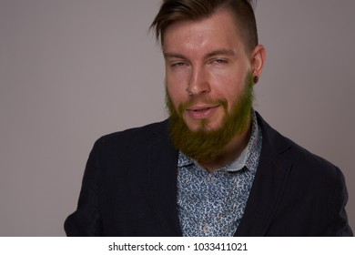 stylish handsome man with a green beard, business