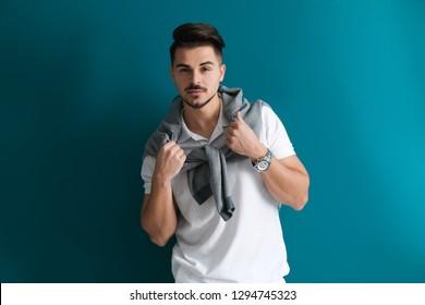 Stylish handsome man on color background