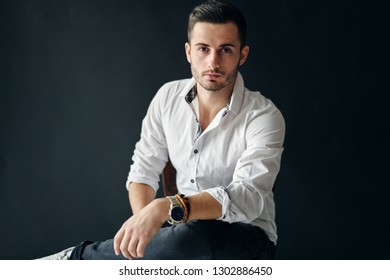 Stylish handsome man portrait on dark background. young and success concept