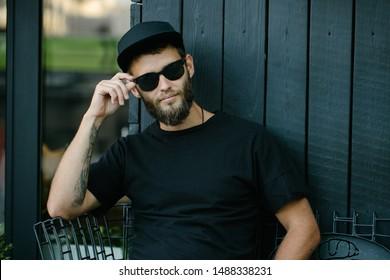 Stylish handsome man wearing sunglassesand smiling