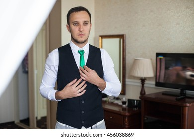 stylish handsome successful confident man in a posh classic room