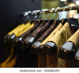 Stylish hanging readymade clothes for men isolated stock photograph.