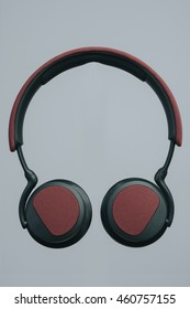 stylish headphones on a gray studio surface isolated red color