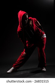 stylish hip hop girl in red over dark background