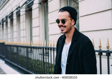 stylish hipster man in sunglasses portrait. male portrait in the city