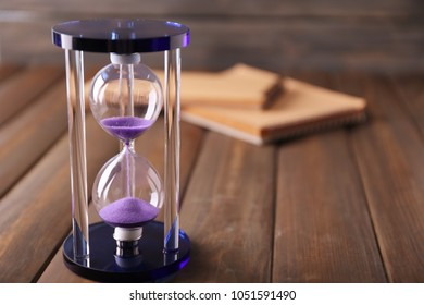 Stylish hourglass on table. Time management concept