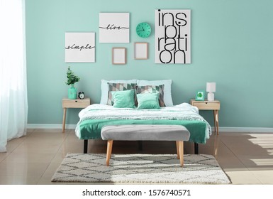 Stylish interior of bedroom in turquoise color - Shutterstock ID 1576740571