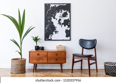 Photo of Stylish interior design of living room with wooden retro commode, chair, tropical plant in rattan pot, basket and elegant personal accessories. Mock up poster frame on the wall. Template. Home decor.