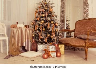 a stylish interior with elegant Christmas tree decorated.