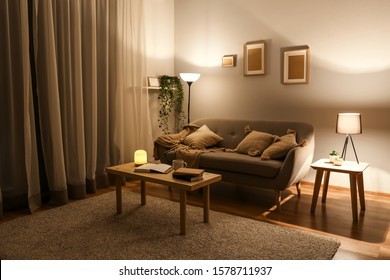 Stylish interior of living room at night