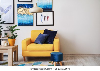 Stylish interior of living room with yellow armchair - Shutterstock ID 1511910044