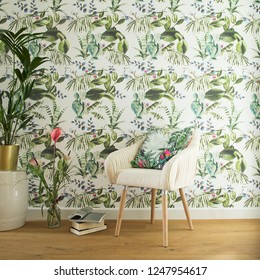 Stylish interior, lovely and bright space to read books or to studdy interior magazines. Floral pattern wallpaper and design armchair.