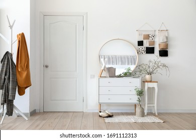 Stylish interior of modern hall with spring flowers