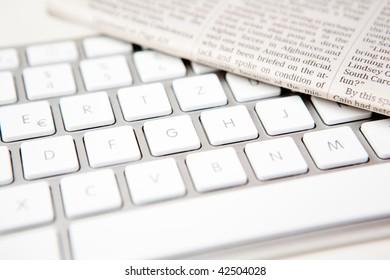 stylish keyboard with newspaper